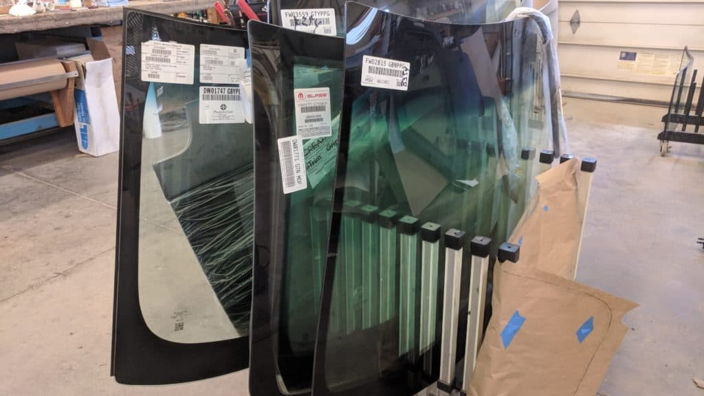 photo of automotive windshields in a rack